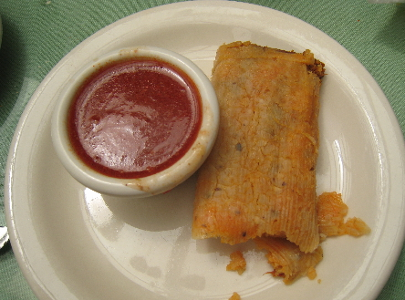 Tamale with red chile on the side