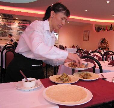 Mousho pork being prepared tableside