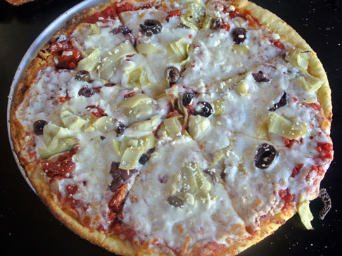 Greek Pizza: Sun-dried tomato, kalamata olive, artichoke heart & feta