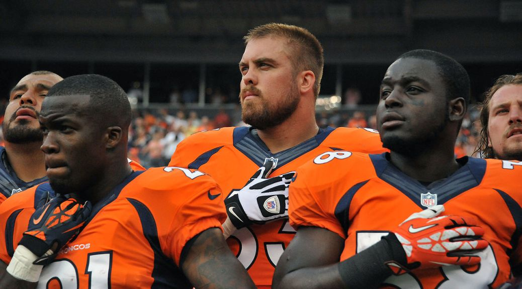 ronnie_hillman_ben_garland_and_montee_ball_listen_to_national_anthem_denver_broncos_2013-08-24