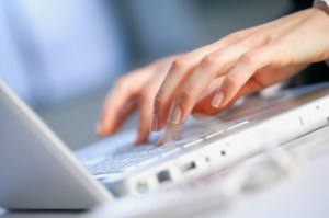 Hands of Businesswoman Using Laptop