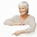 Senior Woman Looking Over a Wall - Isolated
