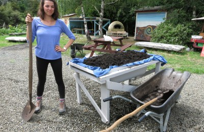 Amanda Kerr stands next to a wicking bed while on co-op at Awhi Farm in New Zealand.