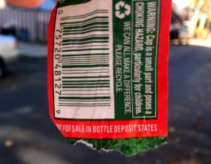 A label peeled from a no-deposit bottle