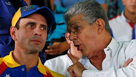 Henry Ramos Allup, president of the National Assembly, speaks to Venezuelan opposition leader Henrique Capriles during a meeting with representatives of the Venezuela's coalition of opposition parties (MUD) in Caracas