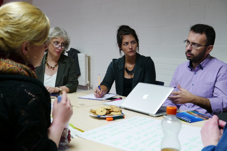"NUCLEUS Field Trip participants Annika Döring, Theda Minthe, Linda van Dijk, and Menelaos Sotiriou reflect on RRI and economy in a ""World Cafe"" workshop discussion."