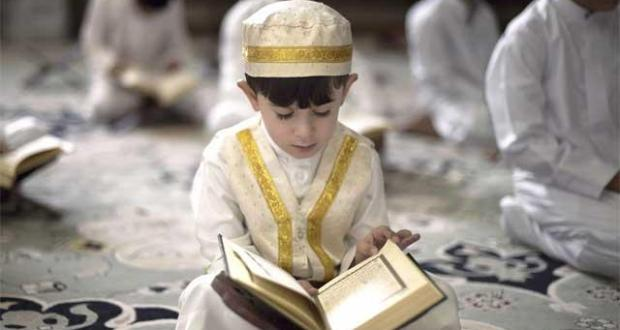 a-young-bahraini-shiite-muslim-boy-reads-the-koran