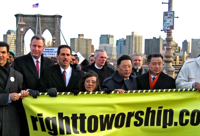 Bill DiBlasio, Fernando & Elvia Cabrera, John Liu marching across Brooklyn Bridge to City Hall. Photo: Christopher Smith/A Journey through NYC religions