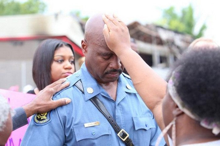 Laying on Hands on Captain Ron Johnson in Ferguson, Missouri. Photo from Instagram