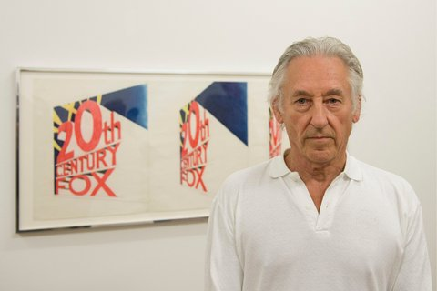 "Ed Ruscha with his ""View of the Big Picture"" (1963) in the Kunstmuseum Basel, in 2013. Mr. Ruscha will give 18 recent artworks to the Tate collection, as part of his gift.Credit Georgios Kefalas/European Pressphoto Agency"