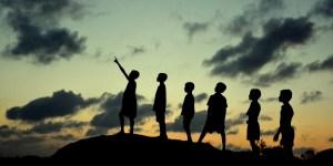 Children watching  cloud formation
