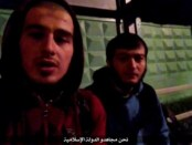 Still image from video posted on social media shows two Islamic State spokespersons of the Islamic State, as they claim responsibility for an attack on a traffic police post outside Moscow
