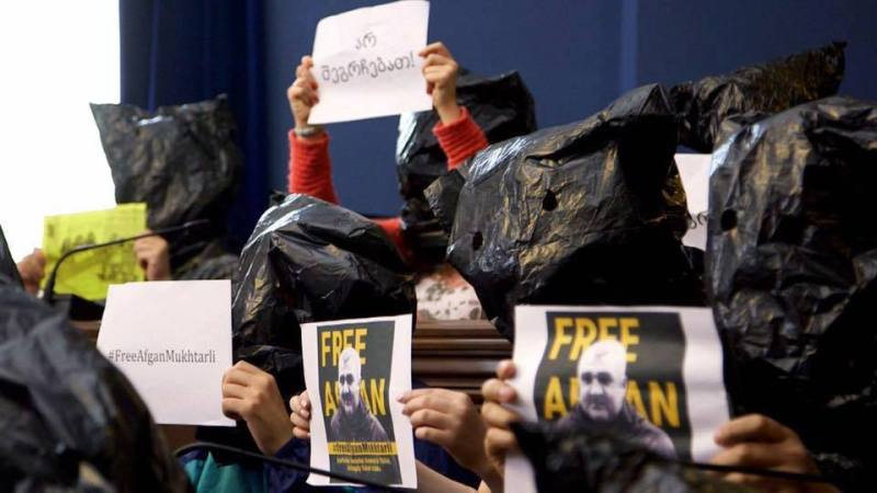Journalists and activists demonstrate inside the Georgian Parliament building by putting bags over their heads. Mukhtarli says his kidnappers pulled a bag over his head as they were driving him to Azerbaijan. (Photo: Tornike Mandaria/On.ge)