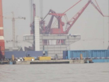 "Pictures surfaced today of a module at Shanghai's Changxing Island Shipyard appear to be proof of a second Chinese carrier under construction. Besides the telltale profile of the inner hull of a KUZNETSOV-class carrier, the module features a well-defined hangar and elevator cutout. Additionally a possible catapult trench has been identified, lending credence to postulation that this first all-Chinese carrier will be a refinement of the LIAONING/EX-VARYAG Soviet design, most likely designated 001A-class (Source: ""IDENTIFIED UNDER CONSTRUCTION: China's Second Aircraft Carrier"", China Defense Blog, 01.08.2013)."