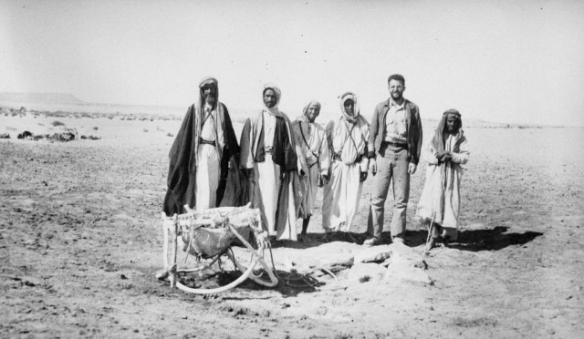 Aramco pioneers Tom C. Barger, geologist and later CEO of Aramco, and Khamis ibn Rimthan, legendary Bedouin guide, and other field party members in'Ain al-Tarfa, Eastern Province, February 1938.