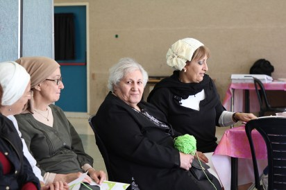 elderly french immigrants in a social setting