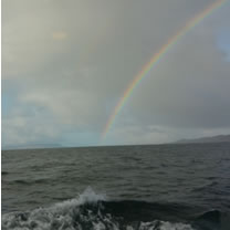 Photo of a rainbow taken from the Armadale to Mallaig ferry in May 2016 by Simon Ager