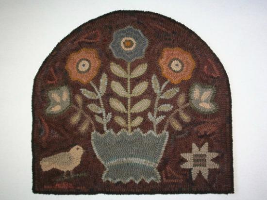 primtive hooked rug flowers