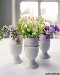 These egg centerpieces from martha stewart have been placed in an egg cup but you can also use a small basket or bowl