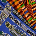 African-Fancy-Print---Gathering-on-Blue,-Plaid-Squares,-Symbols-on-Purple