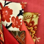 A selection of red decor fabrics.