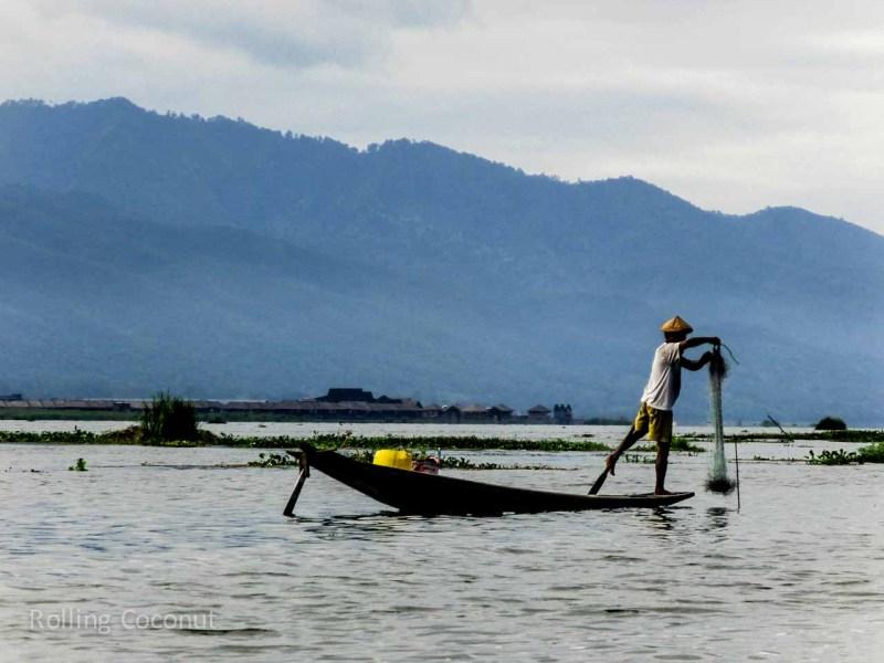 Myanmar Itinerary Inle Lake Fisherman With Net Rolling Coconut Ooaworld Photo Ooaworld