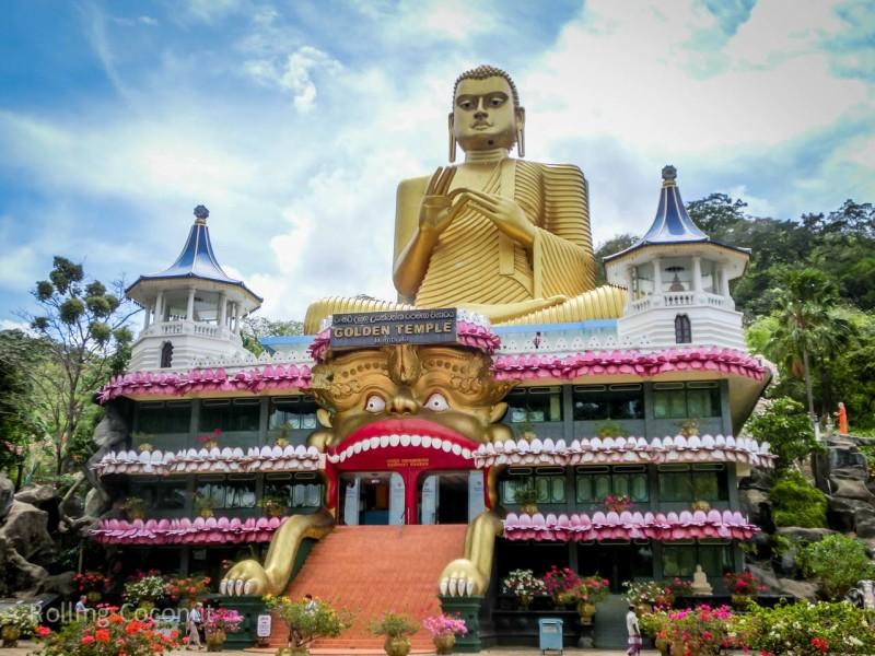 Dambulla Sri Lanka Itinerary Golden Temple Entrance ooaworld Rolling Coconut Photo Ooaworld