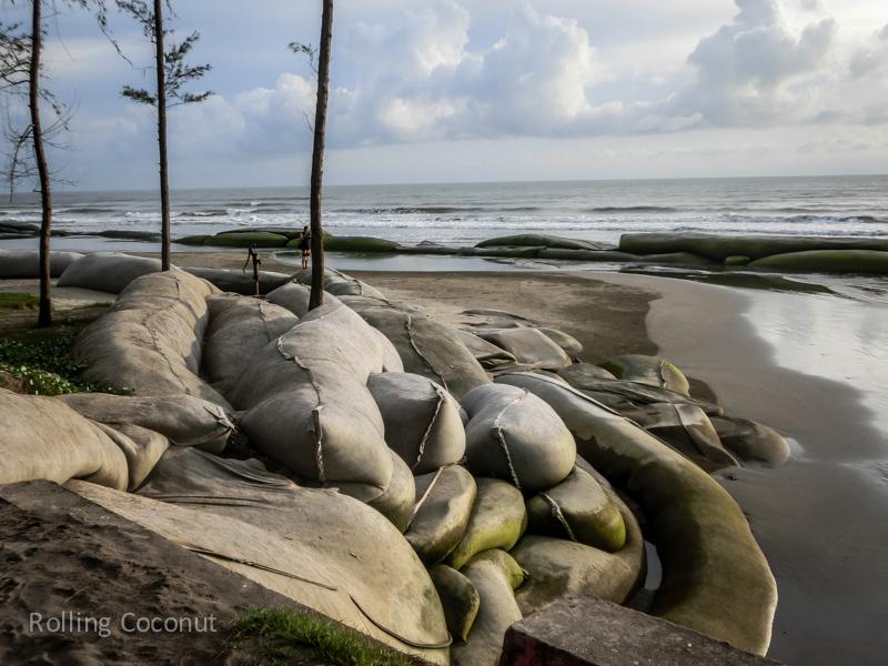Bangladesh Cox's Bazar Inani Beach Sandbags Protection ooaworld Rolling Coconut Photo Ooaworld