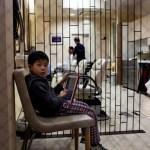 Child waiting at Kyoto barber shop Japan