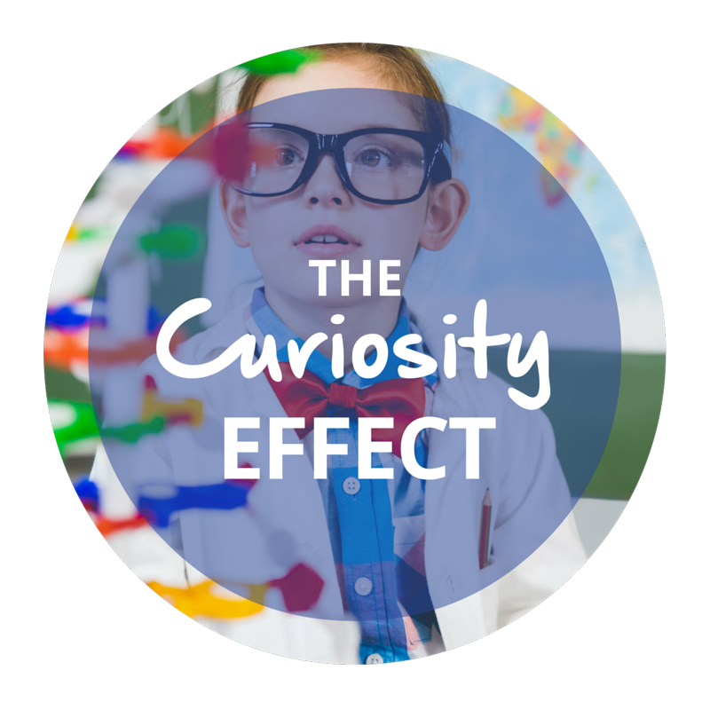 "The words ""The Curiosity Effect"" overlay an image of a young person looking at a colorful structure who is wearing dark glasses, a red bow tie, a blue shirt, and a lab coat."