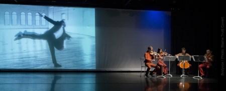 Hampton on screen, musicians onstage. Photo: Blaine Truitt Covert