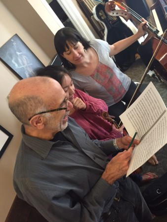 Schiff works with members of FearNoMusic for this Sunday's concert.