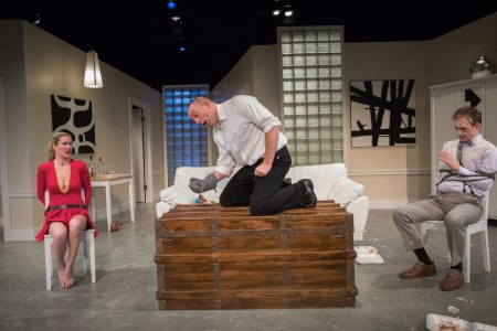 The dinner party of Kelly Godell, left,   takes a turn when thumping comes from the trunk. Leif Norby investigates because Rolland Walsh is all tied up./Owen Carey