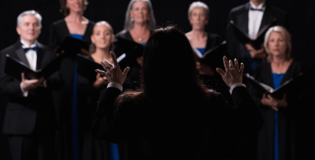 """Diane Retallack conducts Eugene Vocal Arts in the world premiere of """"Shadow and Light."""" Photo: Eugene Concert Choir."""