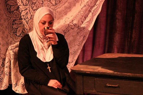 In the drink: Lucy Paschall as Emilia. Photo: Carrie Anne Huneycutt