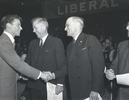 """""""Congratulations, Mr. Truman."""" Frank Sinatra and Henry Wallace congratulate Harry S Truman on winning the vice-presidential nomination at the Democratic National Convention, Chicago; photo by Katherine Joseph, 1944; © Richard Hertzberg and Suzanne Hertzberg; photography courtesy of the Archives Center, National Museum of American History, Smithsonian Institution."""