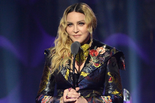 NEW YORK, NY - DECEMBER 09:  Madonna speaks on stage at the Billboard Women in Music 2016 event on December 9, 2016 in New York City.  (Photo by Kevin Mazur/Getty Images for Billboard Magazine)