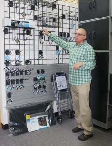 Sales Manager Mike Kornechuk works at the design showcase at Organize-It in Shelby Twp, Mich. Thursday, Oct. 8, 2015.