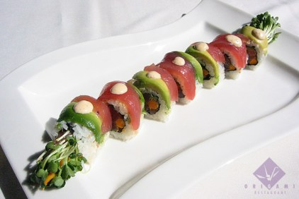 Spicy tuna, tempura flakes, burdock, and kaiware wrapped in tuna & avocado (8 pieces) ... $16.75