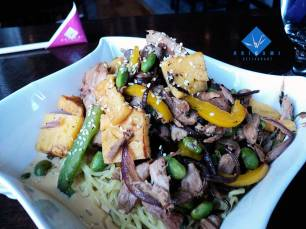 Braised Duck Mazemen (mixed Ramen noodle), with Kikurage Mushrooms, edamame, bell peppers, red onion and sweet egg tossed in a sesame sauce.