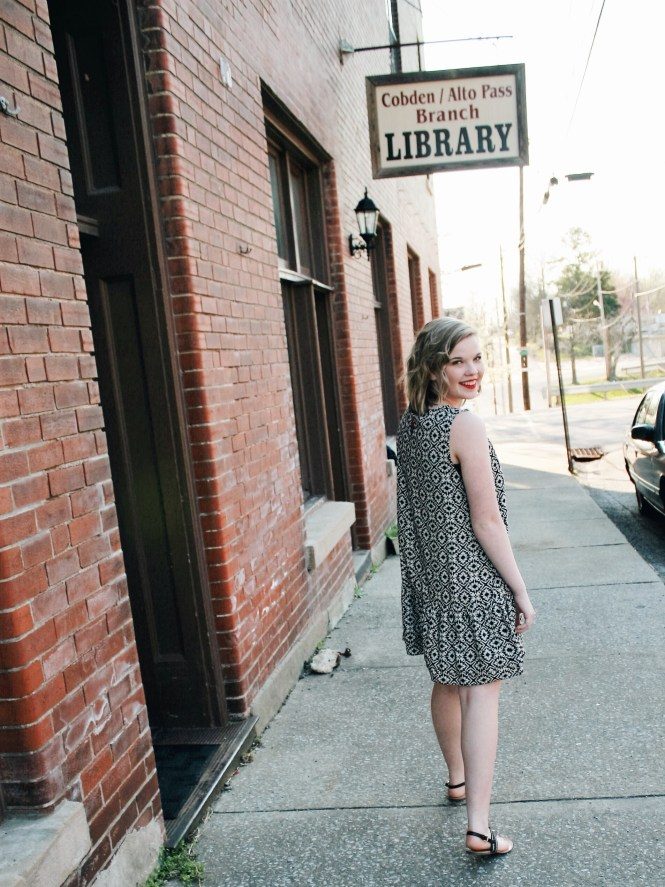 Books and a Dress. Back view of a printed dress from Stash Boutique in Cape Girardeau MO in front of our local library.