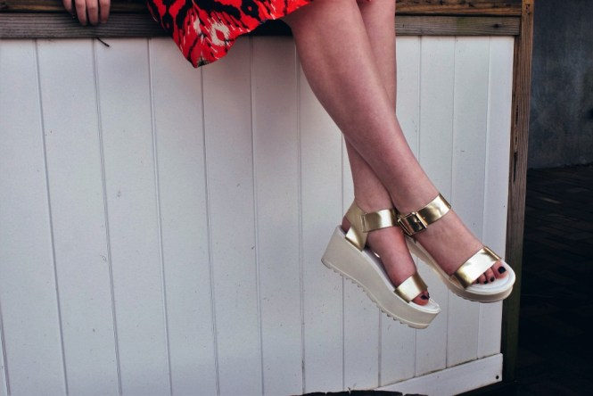 Close up image of the platform sandals and gold detailing.