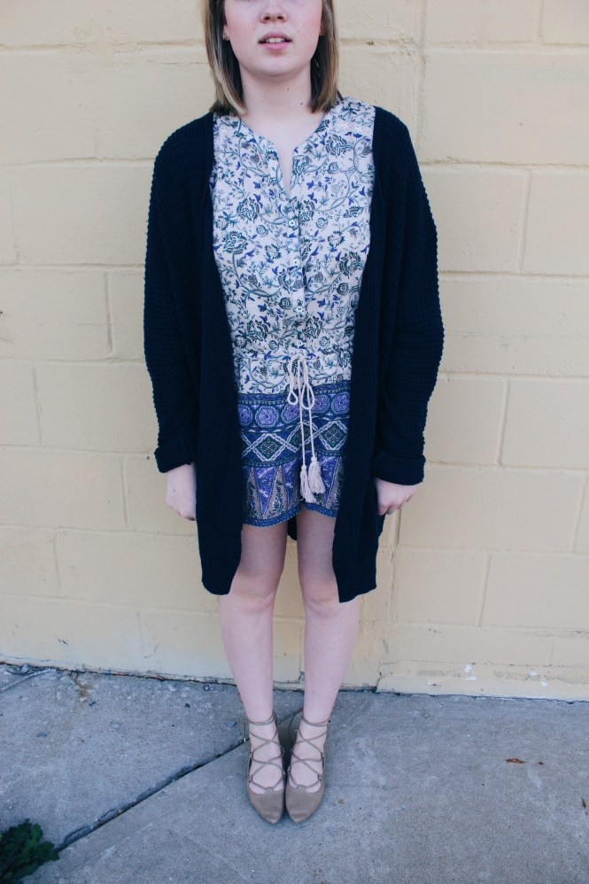 Graduation and a Romper, Modeling a printed romper, oversized cardigan, and lace up flats.