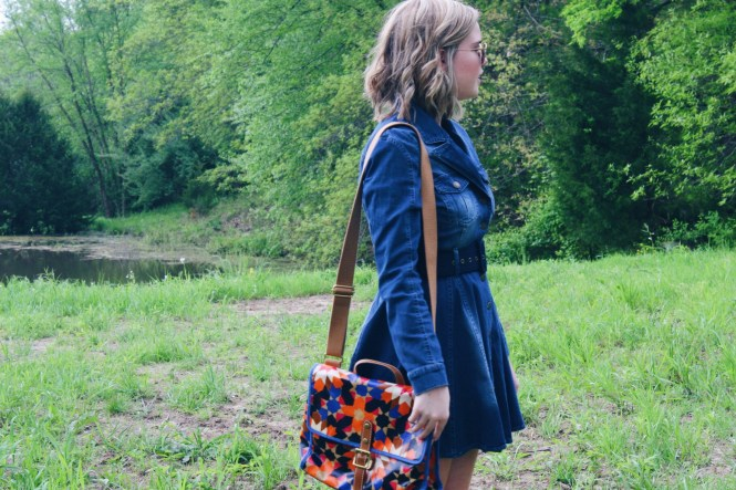 I'm Feeling Inspired By The 70s. Close up of the pleated denim dress and a printed Fossil purse.