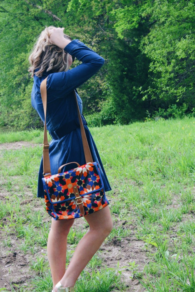 I'm Feeling Inspired By The 70s. Side view of the of the pleated denim dress, platform sandals, and a printed Fossil purse.