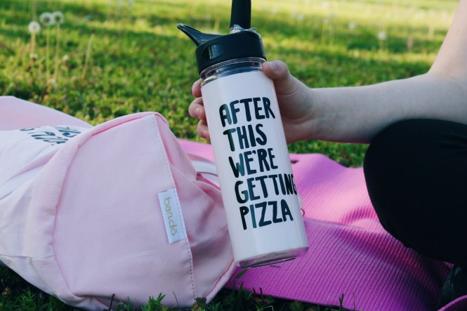 "Workout Playlist, Accessories, and Outfit. Close up of ""After This We're Getting Pizza"" water bottle.."