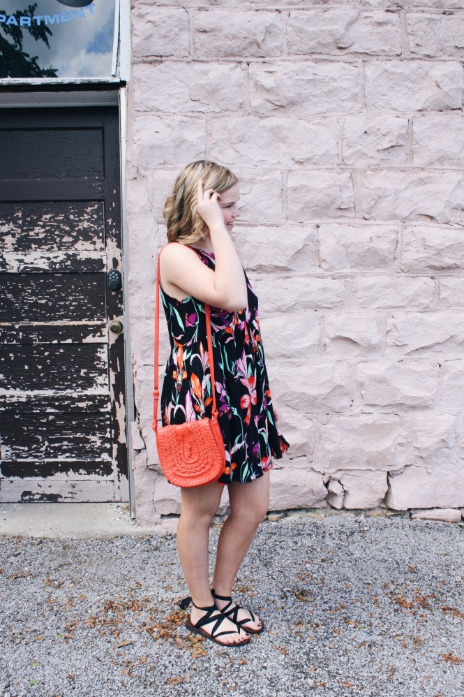 It's All In The Details. Modeling a floral printed dress, orange cross body purse, and lace-up Sseko sandals.