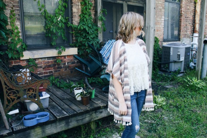 Mix & Match. Modeling a striped poncho, a lace tank top, and boyfriend jeans.