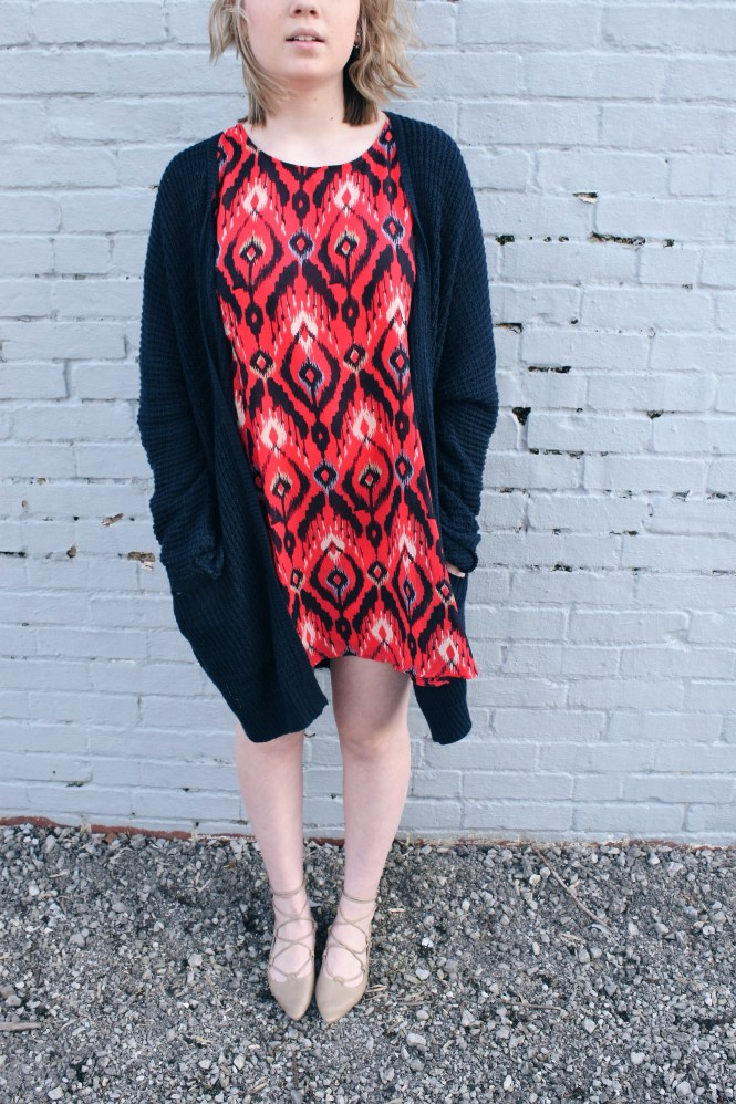 Tone It Down. Modeling a printed dress, over sized cardigan, and lace up flats.