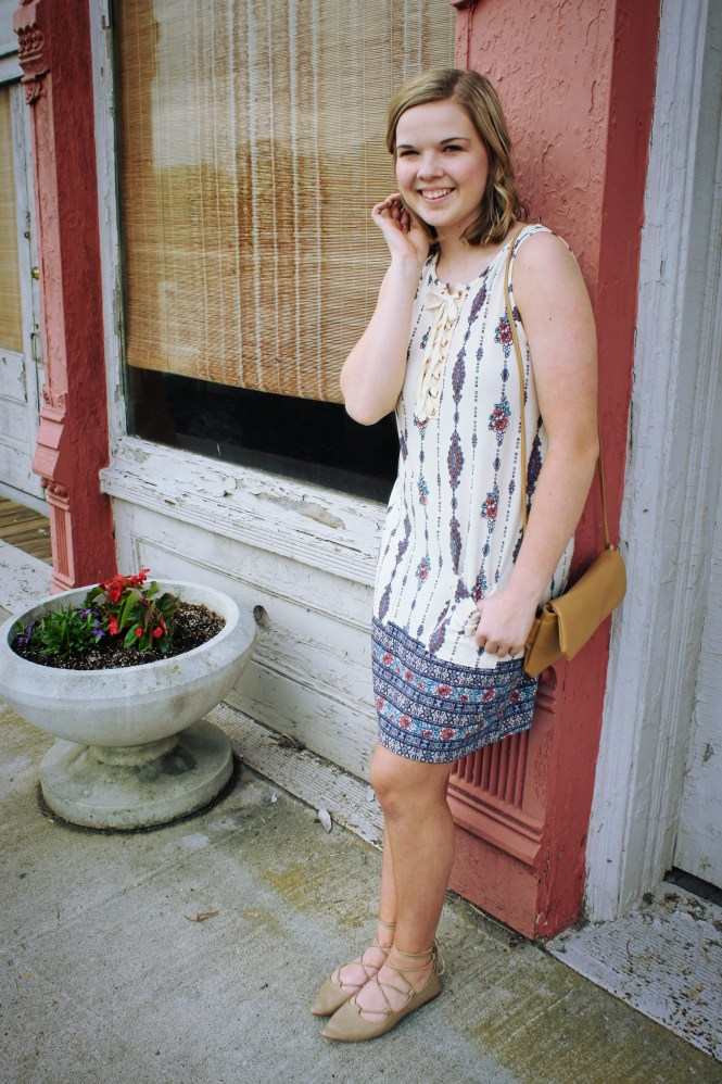 Lace Up. Modeling a lace up, printed dress, cross body, and lace up flats.